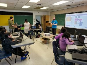 Kai Hutchence teaching a coding workshop for Kids Code Jeunesse at White Bear Reserve