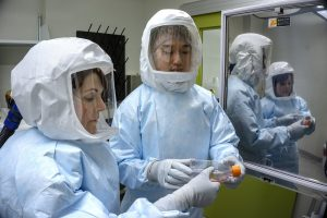 Research technicians Jill Van Kessel and Ze Lim working in VIDO-InterVac's containment level 3 facility. Photo USask - Gord Waldner